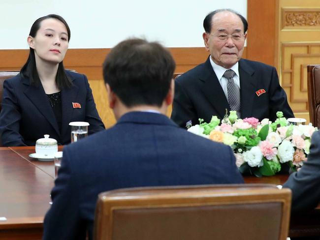 South Korea's President Moon Jae-in (back to camera) talks with Kim Yo Jong (left), North Korean leader Kim Jong Un's sister, and North Korea's ceremonial head of state Kim Yong Nam (right) during their meeting at the presidential Blue House, Picture: AFP/YONHAP