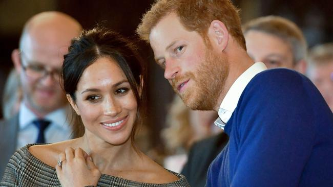Britain's Prince Harry and his fiancée US actress Meghan Markle in  Cardiff, south