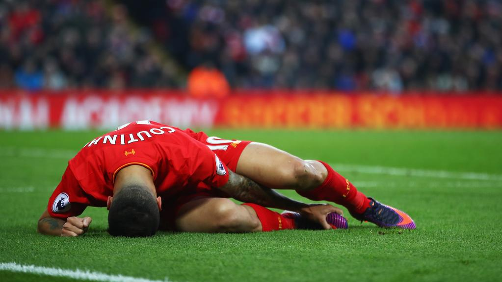 Philippe Coutinho of Liverpool lies injured during the Premier League match against Sunderland at Anfield.