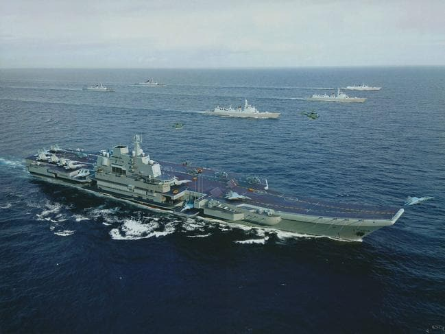 The Chinese aircraft carrier Liaoning and a formation of escorting warships. This is said to be its first large-scale live-fire drill.
