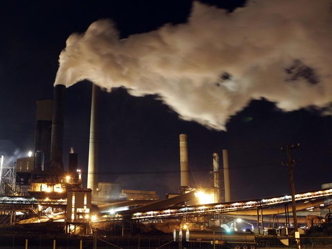 Polluters likely not to have to pay the carbon tax from July 1 but will consumers see the benefits? AP Photo/Rob Griffith