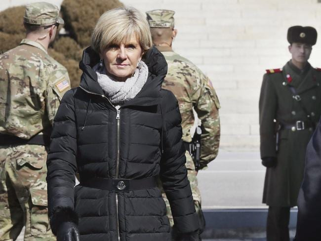 Australian Foreign Minister Julie Bishop visits as US soldiers and a North Korean soldier, right, stand guard at the border village of Panmunjom in Paju, South Korea. Picture: Lim Byung-shick Yonhap via AP