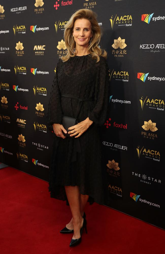 Rachel Griffiths makes a late arrival on the red carpet in all-black.