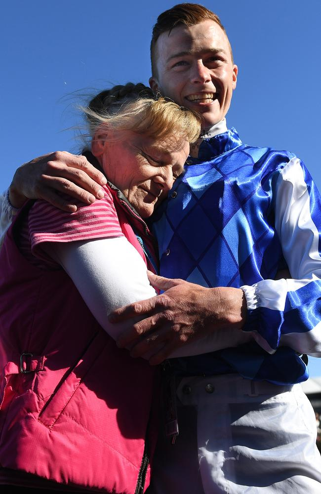 Trainer Udyta Clarke and jockey Patrick Moloney embrace after Rich Charm won on Derby Day last year. Picture: AAP