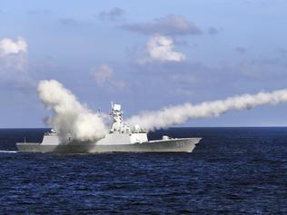 The Chinese missile frigate Yuncheng launches an anti-ship missile during a military exercise in the waters near south China's Hainan Island and Paracel Islands at the weekend. Picture: Xinhua