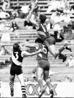 Guy McKenna leaps over teammate Dwayne Lamb and Richmond skipper Dale Weightman in 1989.