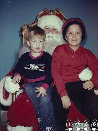 1986 ... The brothers happily sat on Santa's lap. Picture: Martin Gray