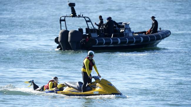 Jet skis and several boats were used by crews in what is now a recovery operation .Picture:Peter Clark