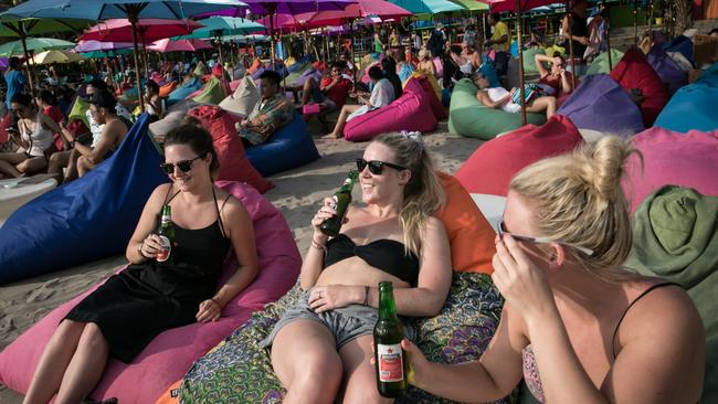 Insurers urge travellers to drink responsibly in 'high-risk' destinations like Bali. Picture: Agung Parameswara / Getty