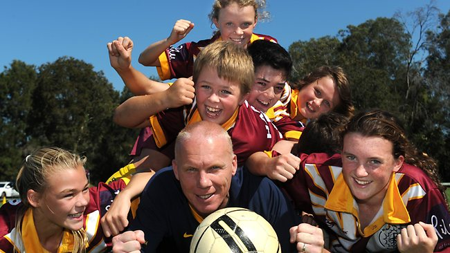 Former Socceroo Robbie Slater with coaching clinic kids at Nolan Reserve, North Manly.