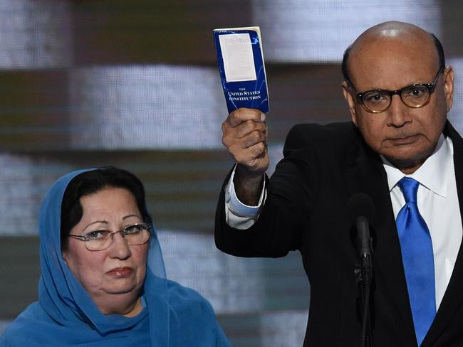 Khizr Khan, with his wife Ghazala, holding his personal copy of the US Constitution. The Khans, the parents of a fallen Muslim American soldier, clashed with Donald Trump during the election campaign. Picture: AFP