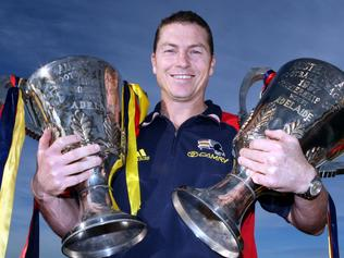 Former Adelaide Crows captain Mark Bickley with the 1997 and 1998 premiership cups. Cup.