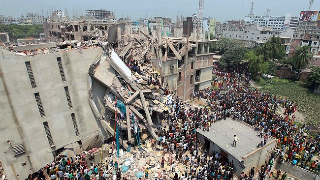 Bangladesh factory collapse: People and rescuers gather after an eight-story building housing several garment factories collapsed in Savar, near Dhaka, Bangladesh, Wednesday, April 24, 2013. Photo: AP/A.M. Ahad