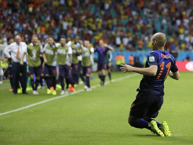 Netherlands' Arjen Robben drops to his knees after scoring his side's second goal during the second half of the group B World Cup match against Spain.