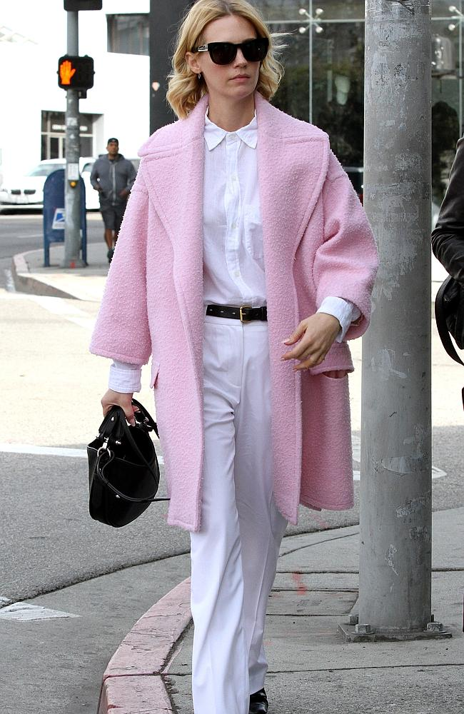 While we're not entirely sold on the baby pink, we love that she's in colour. January Jones out and about in Beverly Hills.