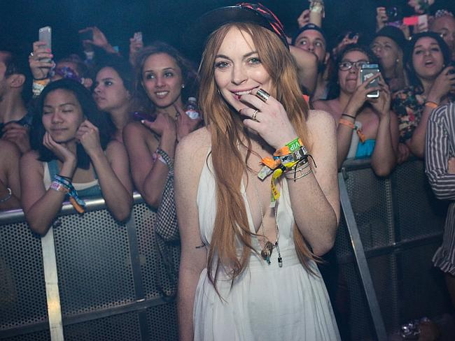 Music festival ... Lindsay Lohan watches Lana Del Rey perform at the 2014 Coachella Music Festival earlier this month. Picture: AP