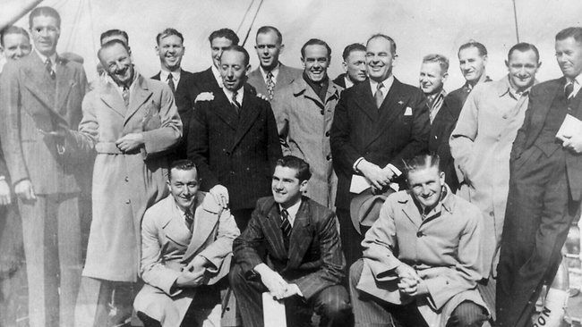 Captain Don Bradman (3rd L) with 1948 Australian tourists on ship travelling to England.