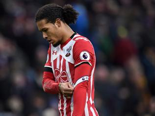 Southampton's Dutch defender Virgil van Dijk walks from the pitch at half time in the English Premier League football match between Burnley and Southampton at Turf Moor in Burnley, north west England on January 14, 2017. / AFP PHOTO / Oli SCARFF / RESTRICTED TO EDITORIAL USE. No use with unauthorized audio, video, data, fixture lists, club/league logos or 'live' services. Online in-match use limited to 75 images, no video emulation. No use in betting, games or single club/league/player publications. /
