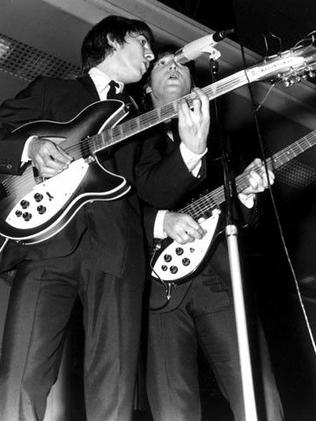George Harrison and John Lennon on stage during one of the concerts at Festival Hall. Picture: Herald Sun Image Library