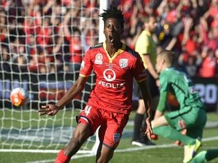 Bruce Kamau of United reacts after scoring during the A-League Grand Final between Adelaide United and the Western Sydney Wanderers at Adelaide Oval in Adelaide, Sunday, May 1, 2016. (AAP Image/David Mariuz) NO ARCHIVING, EDITORIAL USE ONLY