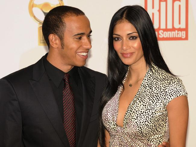 British Formula One world champion Lewis Hamilton and his partner, US singer Nicole Scherzinger in 2008.