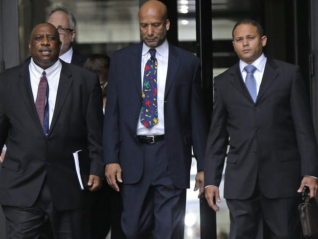 Ray Nagin, centre, pictured federal court after being sentenced in New Orleans for bribery, money laundering and other corruption that spanned his two terms as mayor.