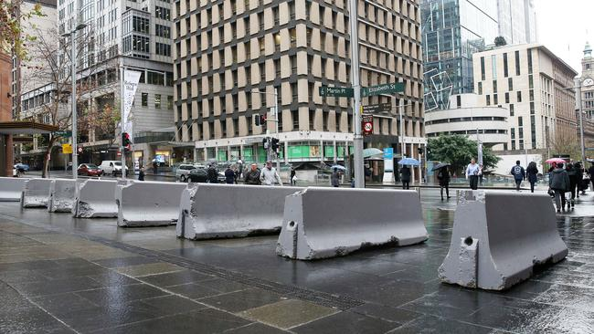 NSW Police said there was no specific terror threat in Sydney's Martin Place and that concrete bollards had been erected as a precaution.
