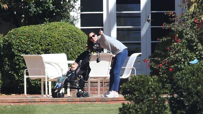 Kate, with camera at hand, makes sure George misses nothing on their stroll. Picture: News Corp