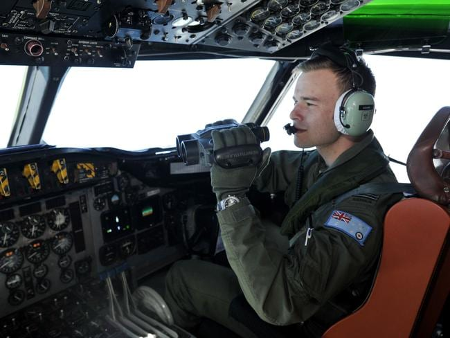 A Royal Australian Air Force AP-3C Orion searches for missing flight MH370. Picture: Pilot Russell Adams searched