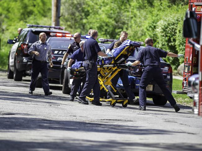 Bizarre attack ... Rescue workers rush the 12-year-old stabbing victim to an ambulance in Waukesha, Wisconsin. Picture: AP