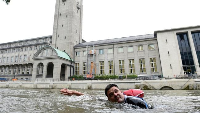 Benjamin David passes the Deutsches Museum on his daily commute. Picture: Andreas Gebert/Reuters