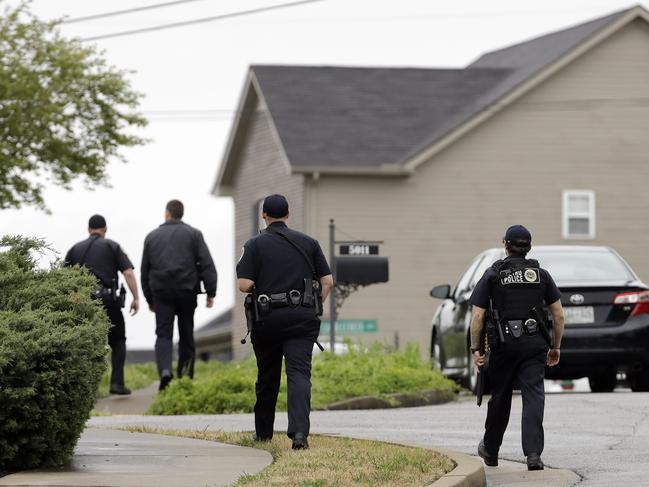 Nashville police officers search a neighbourhood near the Waffle House restaurant. Picture: AP