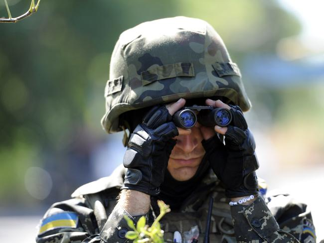 Under occupation ... a member of a Ukrainian volunteer battalion near the small city of Novoazovsk, Donetsk region. Picture: Alexander Khudoteply