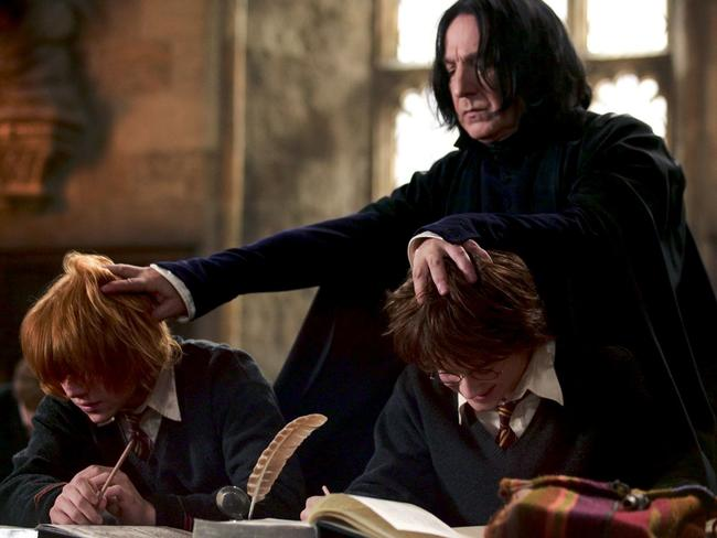 Alan Rickman with Rupert Grint and Daniel Radcliffe in a scene from the 2005 film Harry Potter and the Goblet of Fire.