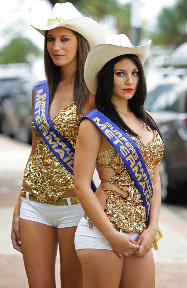 Meter maids Charlotte Mendes (left) and Katie Danielsen patrol the streets of Surfers Paradise. Pic: Luke Marsden