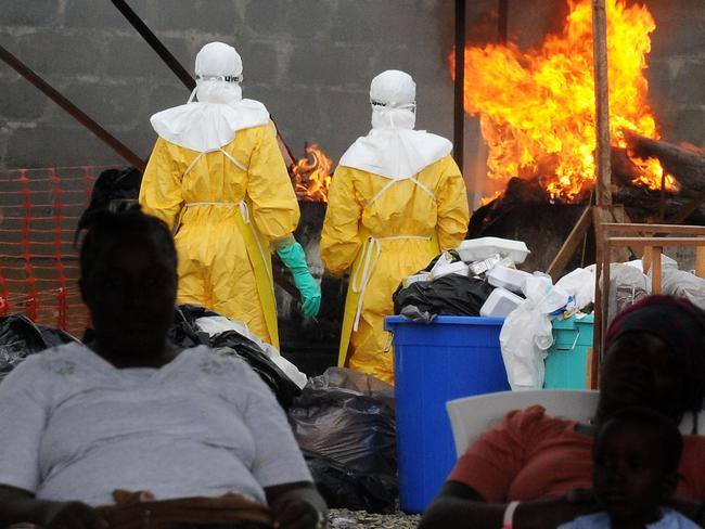 Epidemic ... health care workers burn infected items at the Elwa hospital run by Medecins Sans Frontieres (Doctors without Borders) in Monrovia on August 30, 2014. Liberia has been hardest-hit by the Ebola virus raging through west Africa, with 624 deaths and 1,082 cases since the start of the year. Picture: AFP