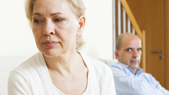 Mature couple having quarrel at home