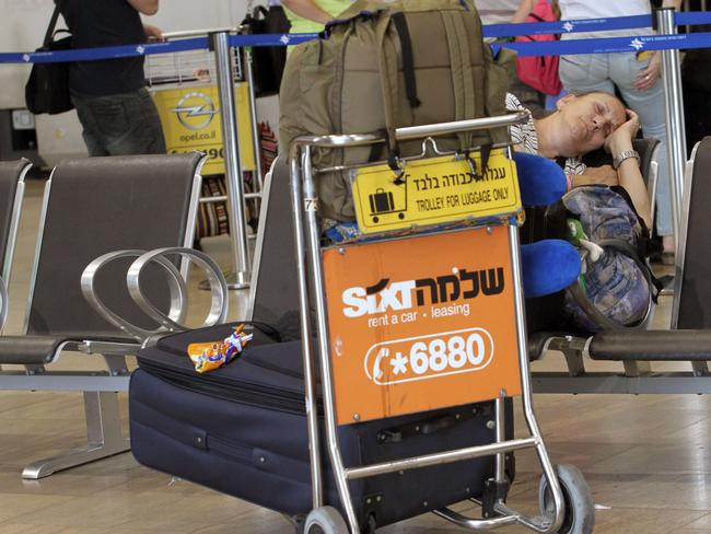 Waiting ... a passenger catches some shut eye in the departure lounge of Ben Gurion International airport.
