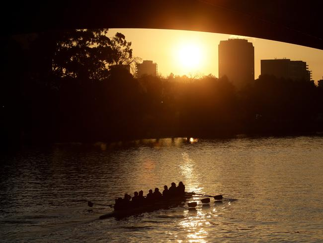 Rowers see the sun rise as they make their way down the Yarra River on Friday, August 15, 2014. Picture: Hamish Blair