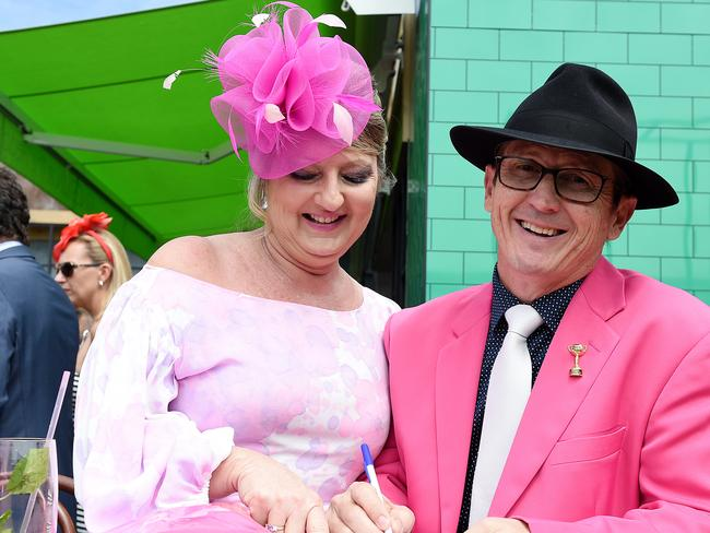 Katie and Phil Tighe are seen studying the form guide in the Birdcage on Melbourne Cup Day at Flemington Racecourse, in Melbourne, Tuesday, Nov. 3, 2015. Picture: AAP Image/Dan Himbrechts