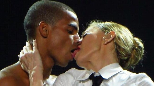 Madonna and her toy boy and back-up dancer Brahim Zaibat French kiss during a concert.