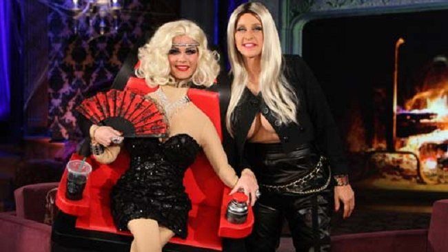 Days of our Lives actress Allison Sweeney as Christina Aguilera in her The Voice chair and Ellen DeGeneres as Nicki Minaj.