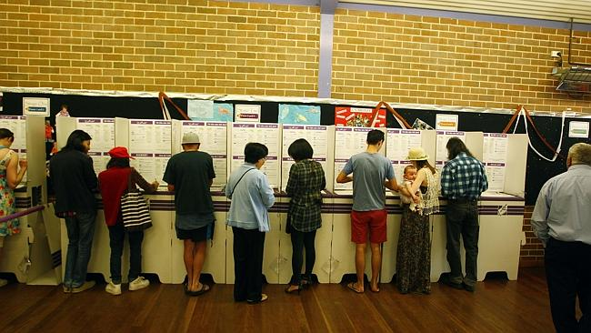 Multiple choice ... voters at Revesby Public School Polling booth during the 2013 Federal Election.