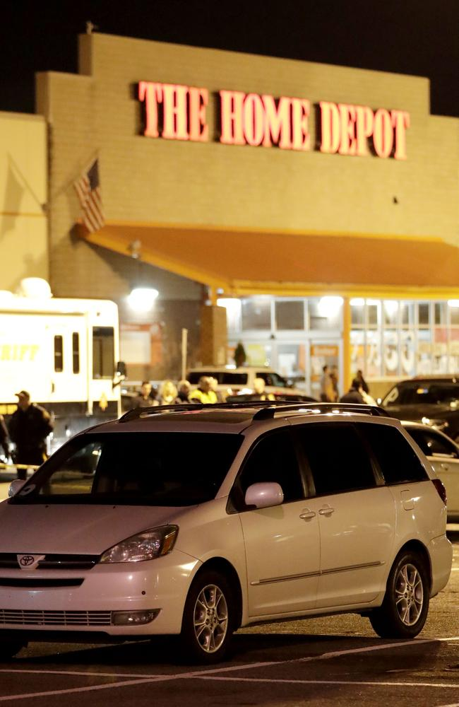 A vehicle is surrounded by a police perimeter in the parking lot of a Home Depot store. Picture: AP