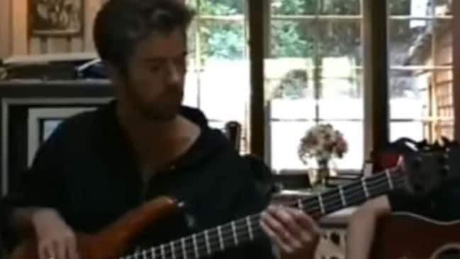 George Michael tries out a bassline in an LA studio while making the unreleased Trojan Souls album.