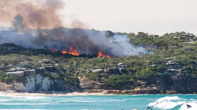 Crews were doing hazard reduction burning on the cliff. Picture: Alex Wilson