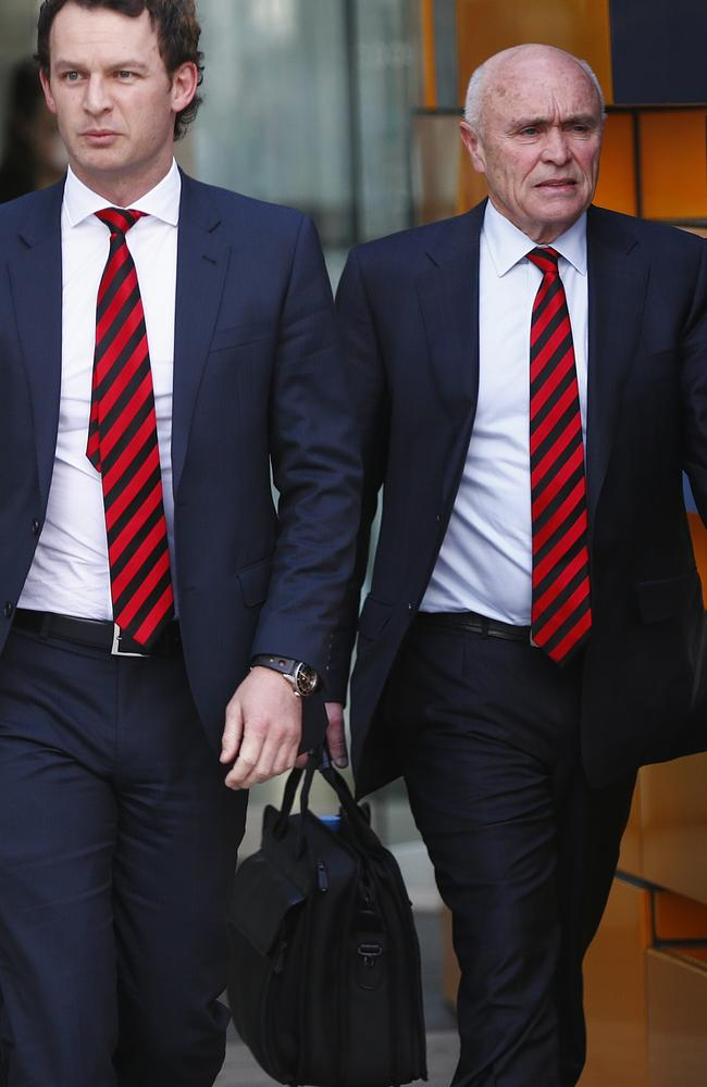 Essendon chief executive Xavier Campbell and president Paul Little leave the Federal Court after on Monday. Picture: Michael Klein