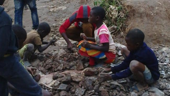 Congolese children sift through broken rock fragments searching for cobalt, the material used to make lithium-ion batteries for our smartphones and laptops.