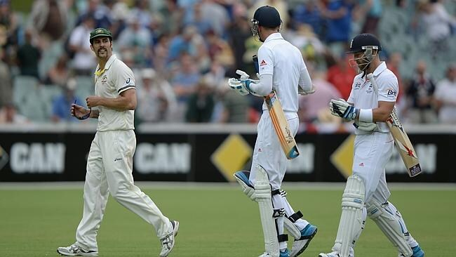 Mitchell Johnson of Australia exchanges words with Stuart Broad and Matt Prior of England as they leave the field at the end of day four of the Second Ashes Test.