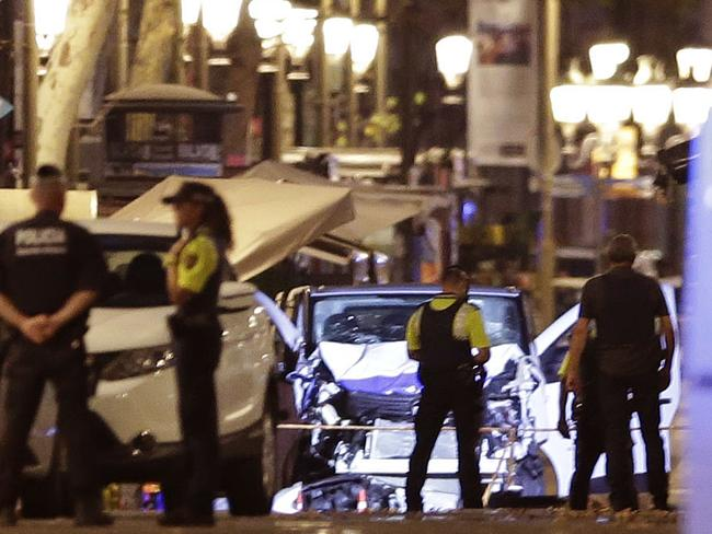 The van mounted the pavement and sped through a pedestrian zone before coming to a halt with an injured person lying near the front wheel. Picture: AP Photo/Manu Fernandez